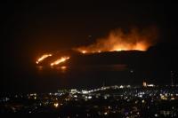 Makilik alanda çıkan yangın yağmurun etkisiyle söndü.