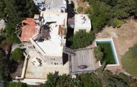 Gazeteci Can Dündar'ın villasının havuzu yıkılarak molozla dolduruldu